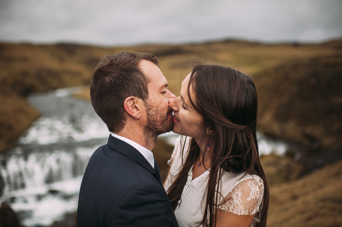 kiss bride groom skogafoss waterfall