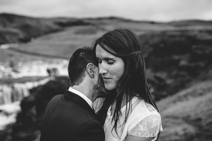 hug bride groom skogafoss waterfall