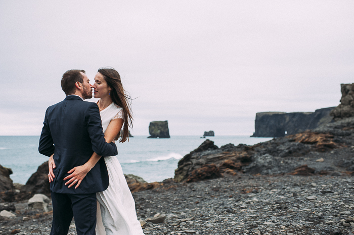 bride and groom kiss vik iceland