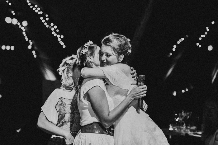 bride bridesmaid hug