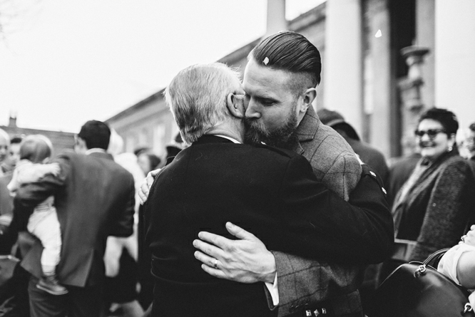 hug-groom-father-wedding-ceremony