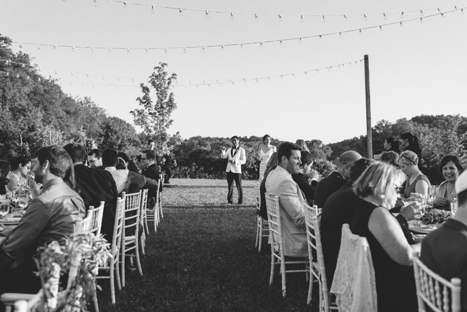 dinner-outside-wedding-barn-bride-and-groom