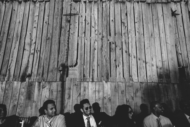 guests-shadows-dinner-wedding-barn