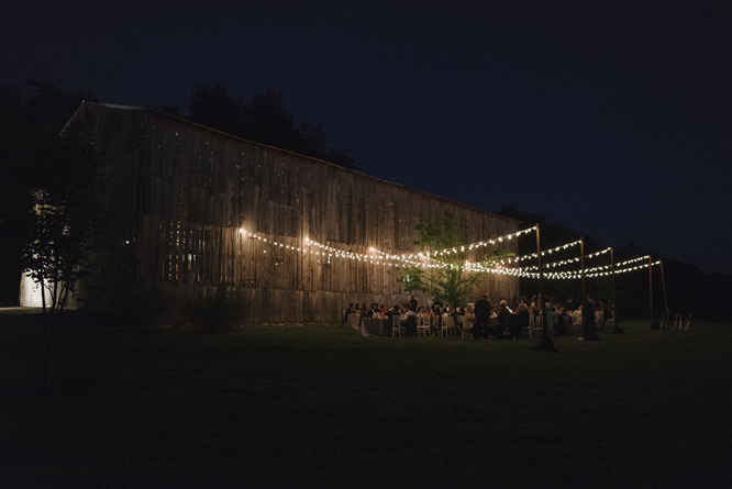 light-string-wedding-dinner-barn-outside